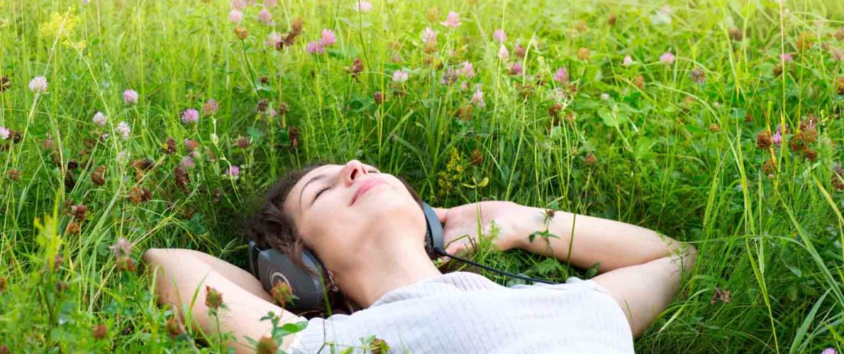 Beautiful Young Woman with Headphones Outdoors. Enjoy Music; Shutterstock ID 105906686; PO: The Huffington Post; Job: The Huffington Post; Client: The Huffington Post; Other: The Huffington Post